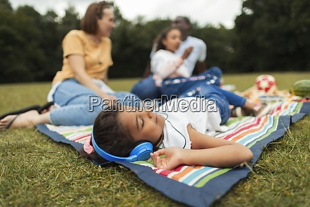 girl with headphones relaxing and listening