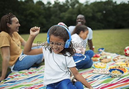 carefree girl listening to music with