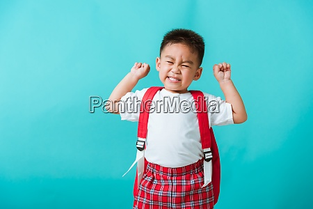 child boy in uniform smile raise