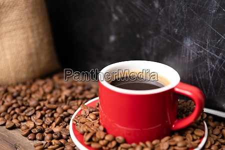 red cup of coffee with coffee