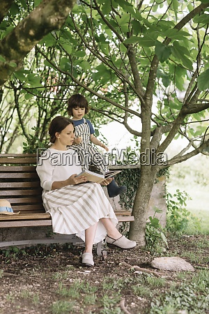 beautiful woman and boy reading book