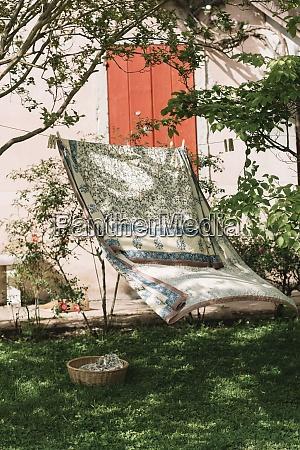 bed sheet hanging on clothesline at
