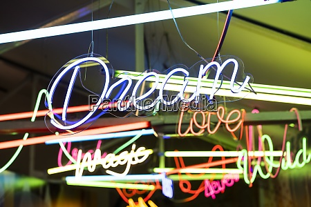 colorful neon signs glowing indoors