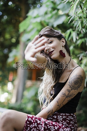 beautiful woman showing stop gesture while