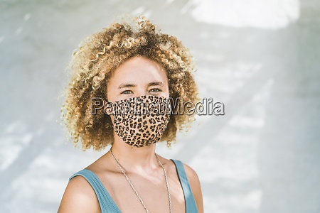 blond woman wearing protective face mask