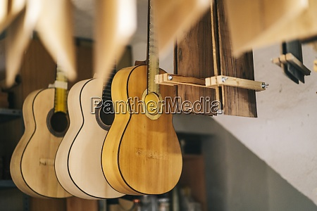 guitars hanging in a line at
