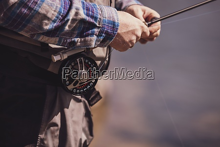 close up of fisherman tying fishing