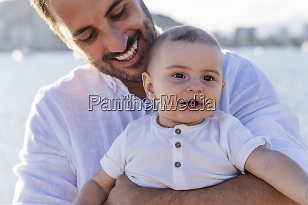 close up of smiling father carrying