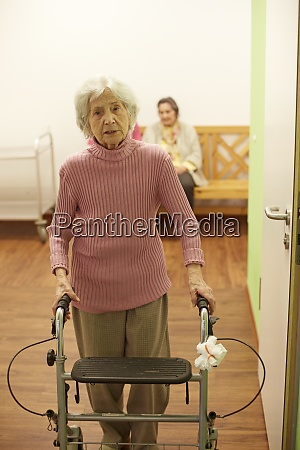 age demented senior woman with wheeled