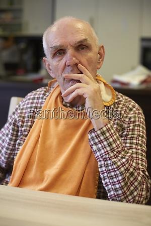 age demented senior man in refectory