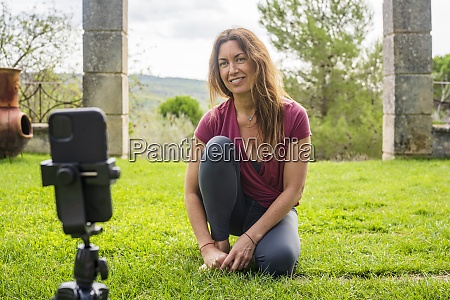 yoga instructor looking at mobile phone
