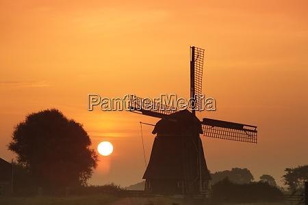 netherlands north holland windmill at sunset