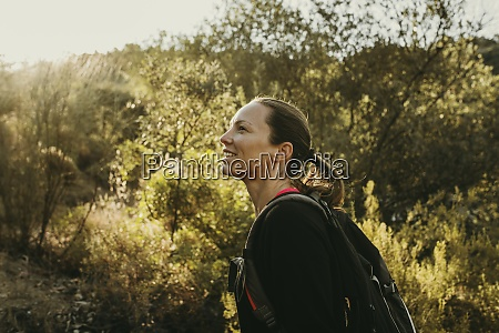 smiling woman exploring sierra de hornachuelos