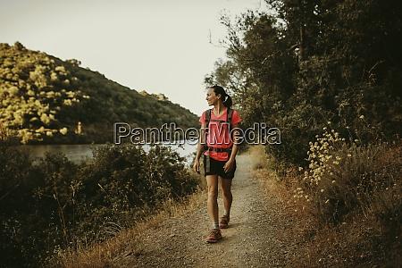 trekker walking on footpath at sierra