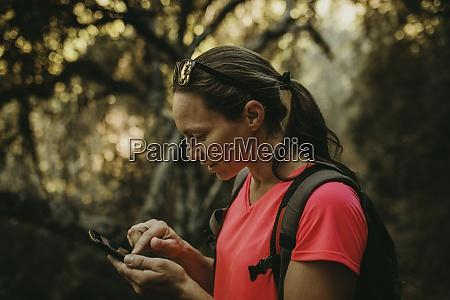 trekker using mobile phone while standing
