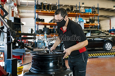 mechanic wearing mask while working in