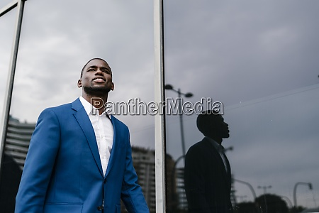 confident male african entrepreneur looking away