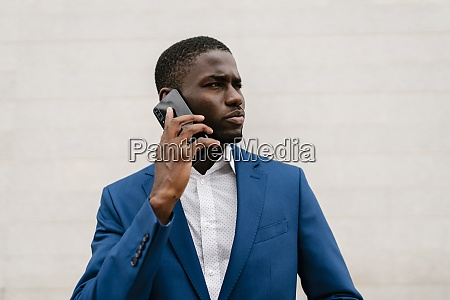 young businessman looking away while on