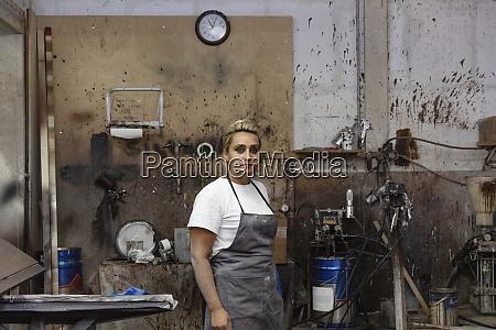 female carpenter standing at factory