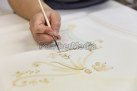 woman hand painting on door at