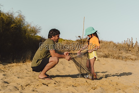 mature man and little girl picking