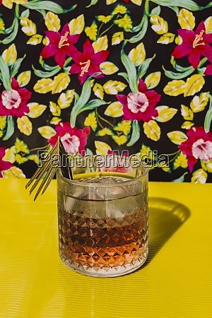 cocktail liquor kept on yellow table