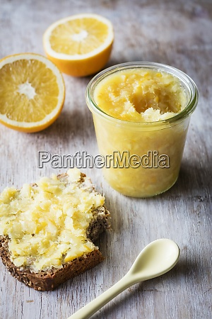 orange jam kept by bread and