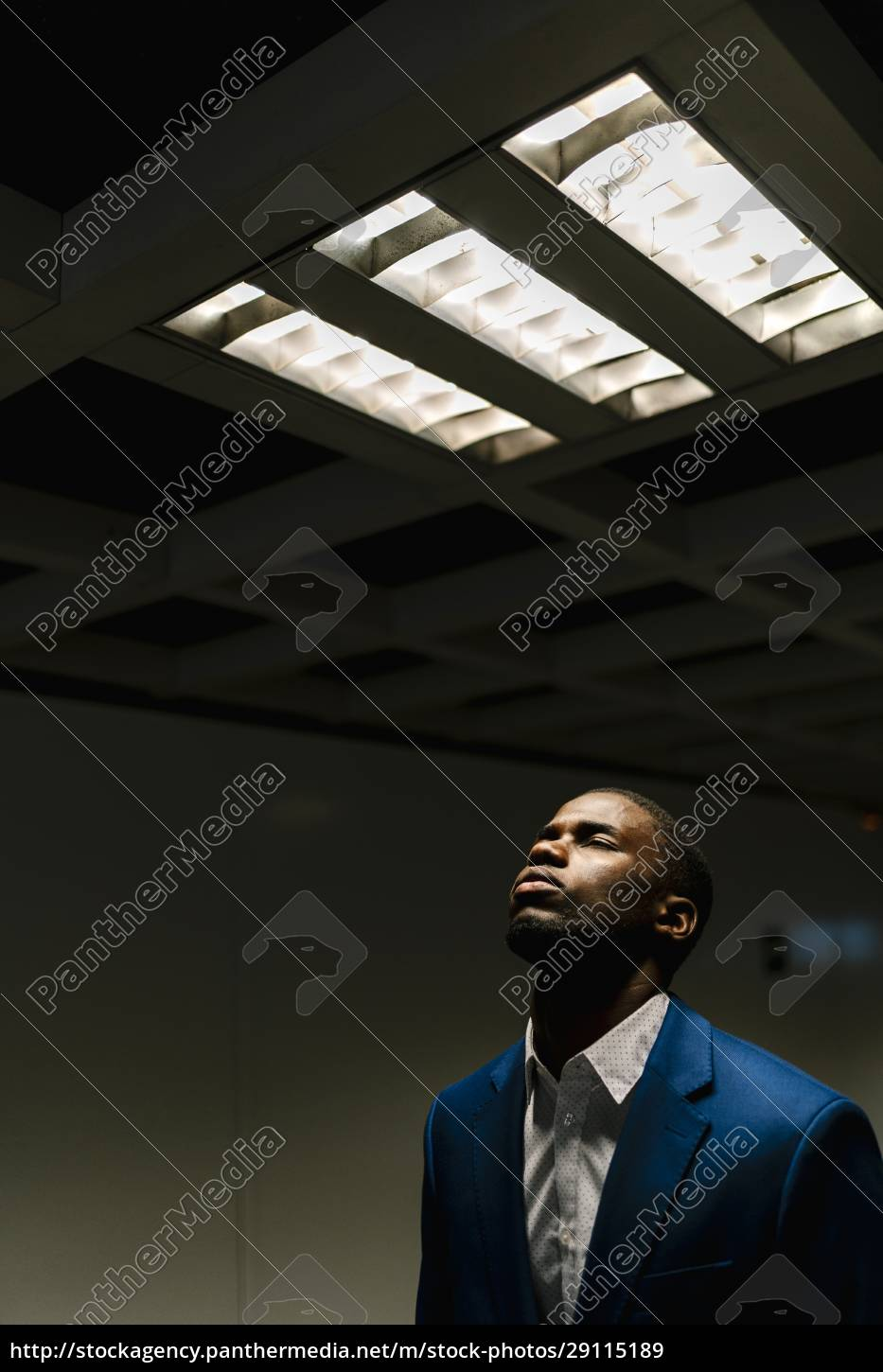 african, businessman, with, eyes, closed, standing - 29115189