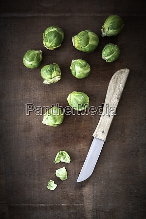 brussels sprouts and a kitchen knife