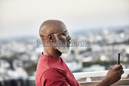 mature bald man with white beard
