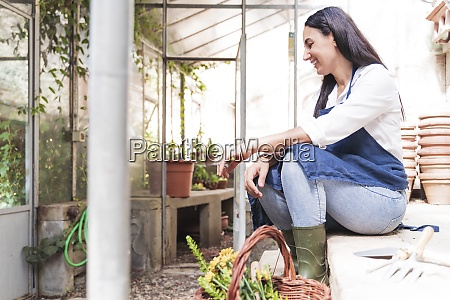 smiling woman looking down while sitting