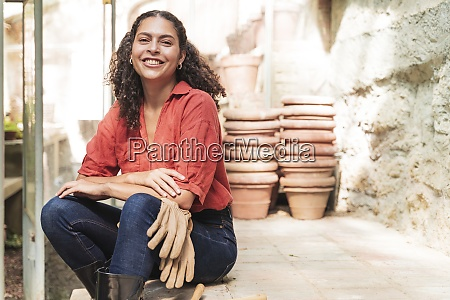smiling mature woman with gardening glove