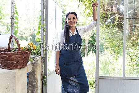 mature woman standing by glass door