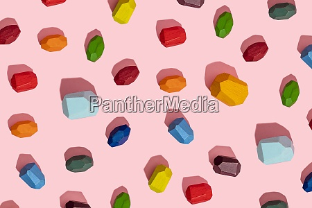 colorful wooden block against pink background
