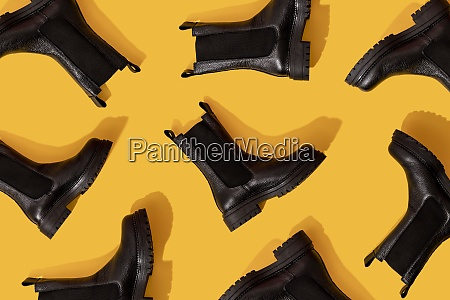 pattern of black leather boots against