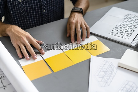 architect choosing shade of yellow on