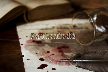 letter on parchment paper with blood