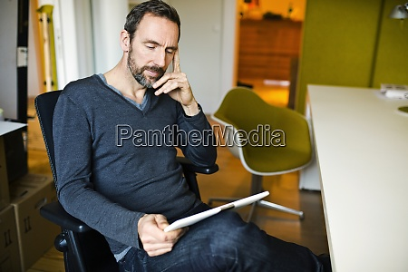 businessman using tablet at desk in
