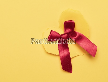 yellow paper heart and red silk