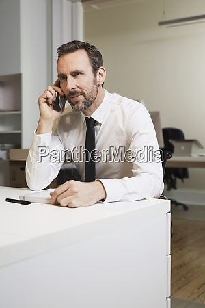 businessman talking on the phone at