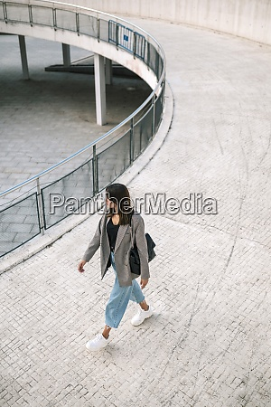 young woman walking in parking lot