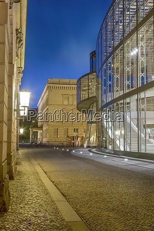 germany berlin narrow cobblestone street between