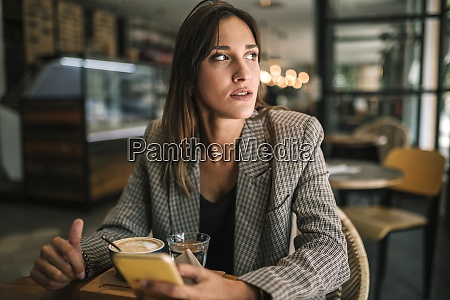 young woman looking away while sitting