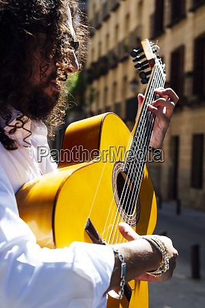 guitarist playing guitar while standing on