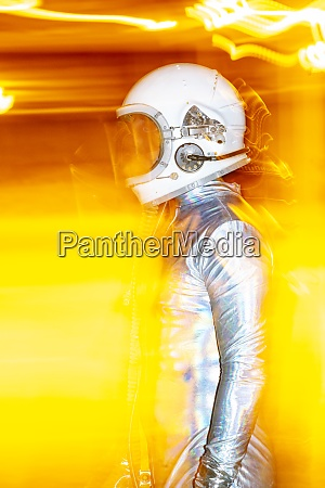 mid adult man wearing space suit