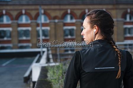 close up of female athlete listening