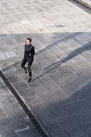 female athlete jumping on rooftop