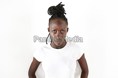 serious young woman with locs standing