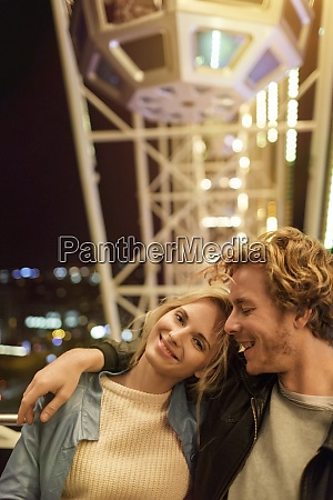 young couple at fun fair with