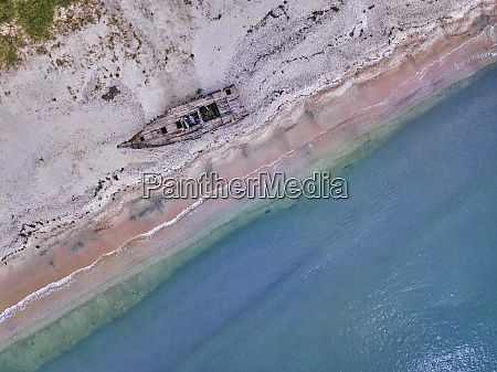aerial view of abandoned boat deteriorating